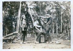 Shaving a workmate with a cut-throat, road building camp, near Dorrigo.