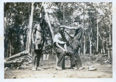 Shaving a workmate with a cut-throat, road building camp, near Dorrigo.