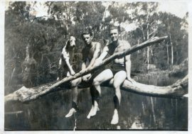 Time off from road building, around Dorrigo, 1930s. Check out the dog's paw.