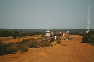 A freight train heads west to Perth, past Wallaroo Siding, deep in the sandplain and granite country of WA.