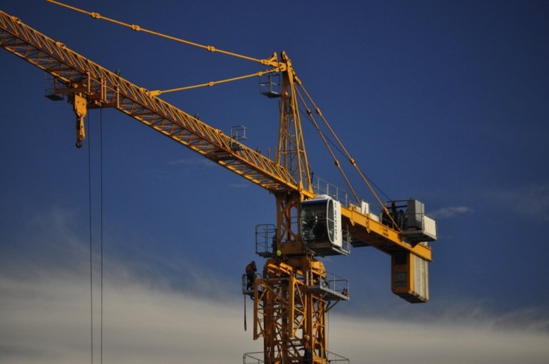 A tower crane looms over Beaufort St, Mt Lawley.