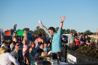 Racegoer Daniel Kelly the moment after he found out he'd won a trip for himself and some friends to an island off the coast of Queensland. A crowd of thousands, and the winner is RIGHT THERE in front of the podium. You couldn't have planned it any better.
