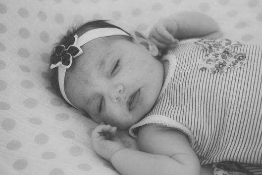 Baby Lara sleeps during her first 'photoshoot'.