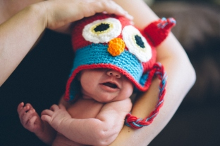 Newborn baby Aria, not quite big enough for her beanie.