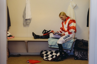 Well-known Kalgoorlie jockey Misty Bazeley relaxes in the change rooms before the running of the 2013 Hannans Handicap, the traditional 'Ladies' Day' on the KBRC race fixture.