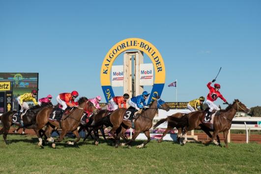 Melbourne Jockey Chris Symons salutes the crowd after winning the 2013 Hannans Handicap on Mr Vadim.